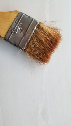 old brush that is worn out Indoors  Close-up Copy Space White Background Brown Paintbrush Built Structure Table Hairstyle Studio Shot No People White Color Brush Still Life Hair Nature High Angle View Home Improvement Wall - Building Feature Messy