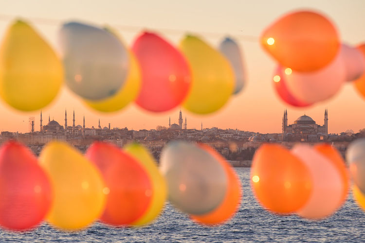 Sunset Baloons Istanbul Mosque Cityview Large Group Of Objects Multi Colored Orange Color Balloon No People Selective Focus Water Nature Variation Choice Reflection Close-up Sky Group Of Objects Order Architecture Built Structure Focus On Background Indoors  Floating On Water The Architect - 2019 EyeEm Awards