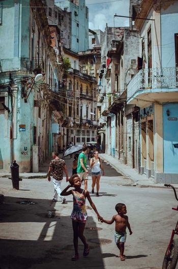 EyeEm Streetphotography Street Photography EyeEm Best Shots Building Exterior Built Structure Day Architecture Outdoors Full Length Child Boys City Real People Childhood Adult Two People Men People Sky Cuba Havana Cuba Havana Street