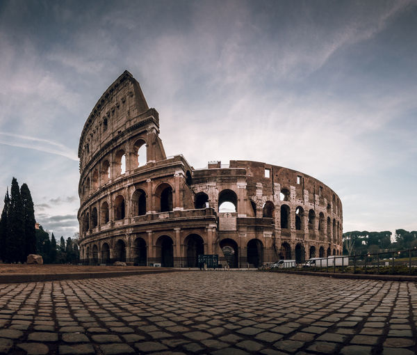 Colosseum in rome at sunrise panorama Architecture Sky History The Past Built Structure Arch Travel Destinations Building Exterior Tourism Travel Cloud - Sky Ancient Nature Old Ruin Amphitheater City Day Arts Culture And Entertainment Incidental People Ancient Civilization Outdoors Archaeology Arched Colosseum