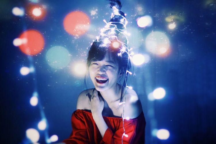 Portrait of happy woman in music concert