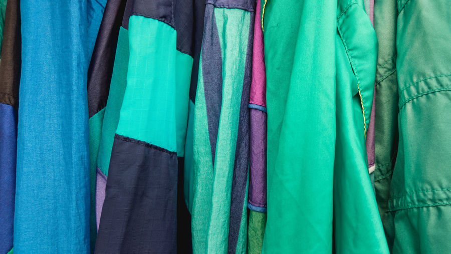 Full frame shot of multi colored clothes hanging in store for sale