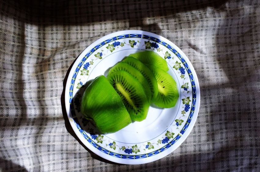 Dessert Close-up Cut Out Day Directly Above Food Food And Drink Freshness Fruit Green Color Healthy Eating Healthy Food High Angle View Indoors  Indulgence Kiwi Kiwi - Fruit No People Plate Ready-to-eat SLICE Still Life Table Tablecloth