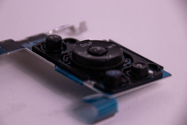 High angle view of camera on table against gray background