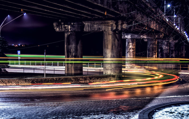 Side View Of Light Trails On Street At Night