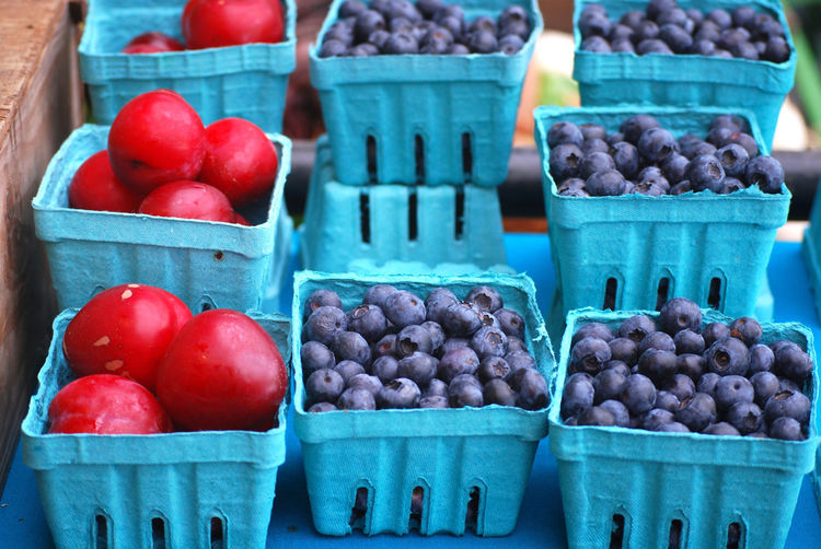 Summer Fruit - Plums and Blueberries Farmers Market Plums Abundance Blueberries Blueberry Container Farmstand Food For Sale Freshness Fruit Healthy Eating Large Group Of Objects Market Market Stall No People Plum Retail Display Still Life Summer Wellbeing