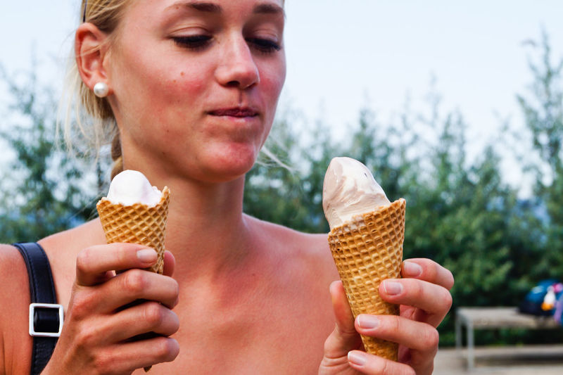Woman looking at ice cream cone