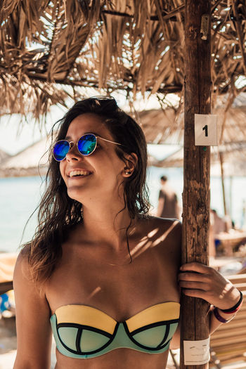 Close-up of young woman in sunglasses