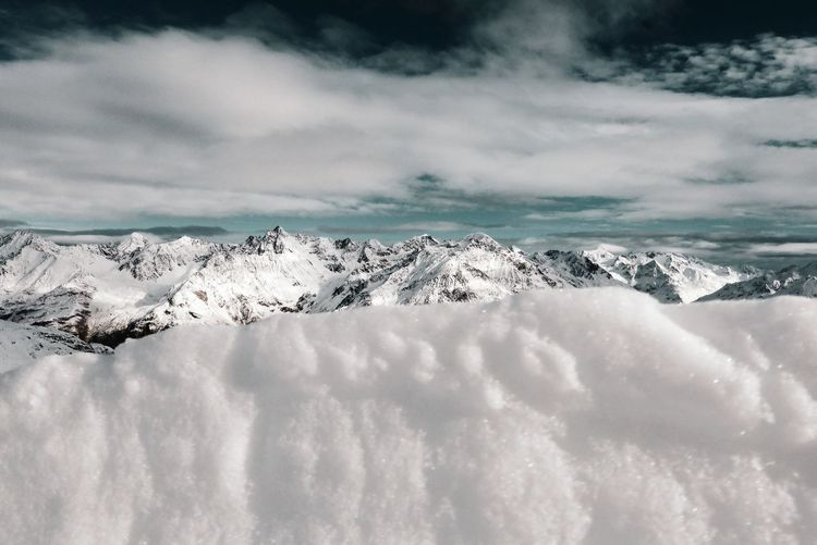 Scenic view of snowcapped landscape against sky
