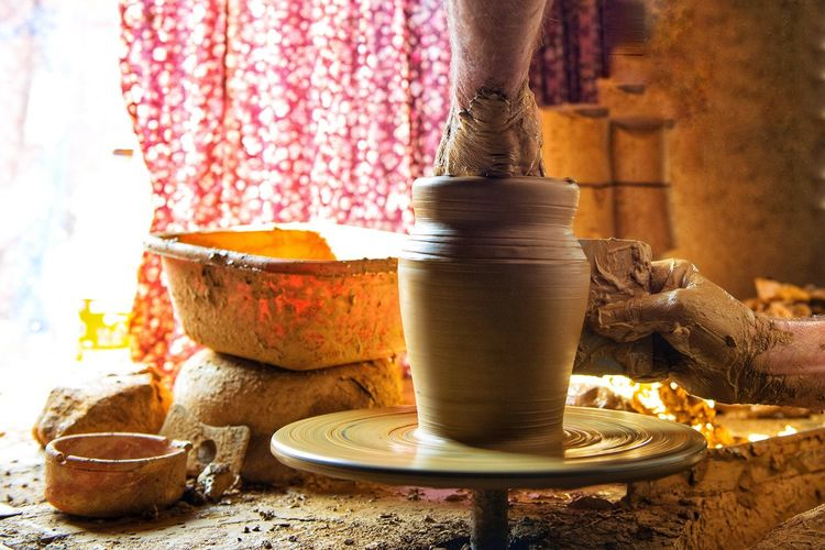 Cropped Hands Of Potter Working At Pottery Workshop
