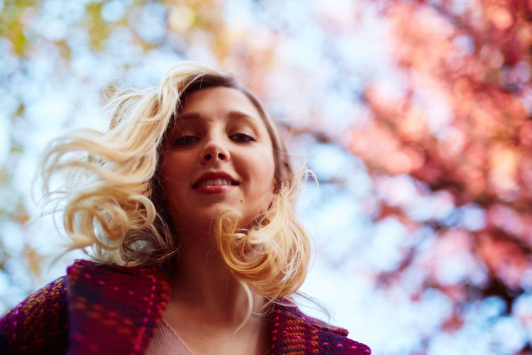 Adult Autumn Beautiful Woman Beauty Beauty In Nature Blond Hair Close-up Day Focus On Foreground Headshot Leisure Activity Lifestyles Long Hair Nature One Person One Young Woman Only Outdoors Real People Sky Smiling Tree Warm Clothing Women Young Adult Young Women