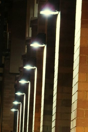 Street Photography Street Lights Walkway Night Lights City Urban Urban Lifestyle Lined Up In A Row Pattern Pieces