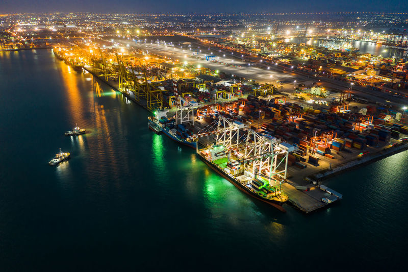 High angle view of commercial dock and shopping containers at night