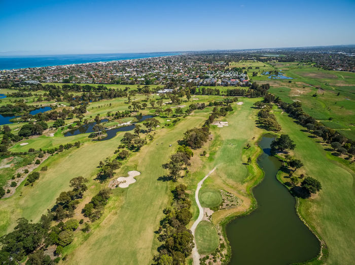 Aerial view of Patterson River Golf Club on a bright sunny day. Melbourne, Australia. Aerial View Beauty In Nature Clear Sky Day Field Golf Golf Course Grass Green - Golf Course Green Color High Angle View Horizon Over Water Landscape Nature No People Outdoors Rural Scene Scenics Sea Sky Tranquil Scene Travel Destinations Tree Water