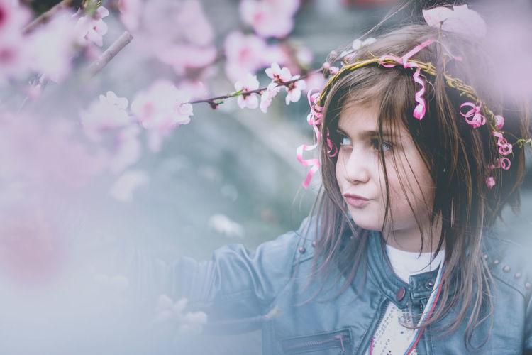 Portrait of girl looking away amidst plants