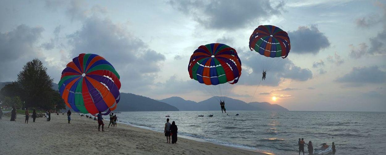 Tourist parachuting at beach