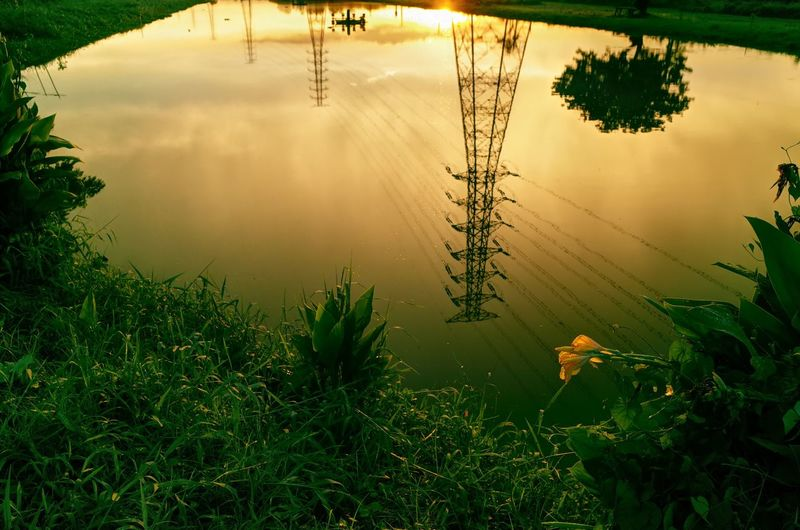 Beauty In Nature Nature Water Electricity Pylon Sunset Lifestyles Outdoors Photoshoot Taking Photos