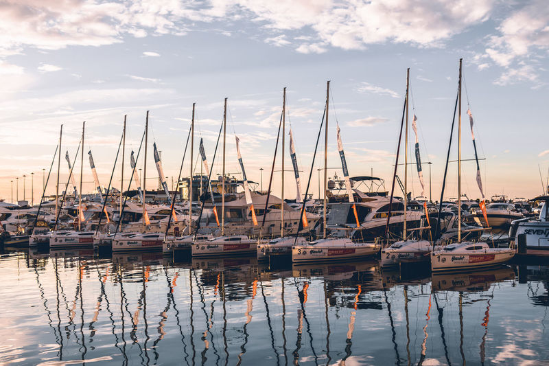 Yachts in harbor. Water Sky Nautical Vessel Transportation Sailboat Cloud - Sky Mode Of Transportation Moored Reflection Mast Harbor Sunset Pole Waterfront No People Nature Beauty In Nature Tranquility Architecture Outdoors Marina Yacht Port Sochi Marina EyeEmNewHere
