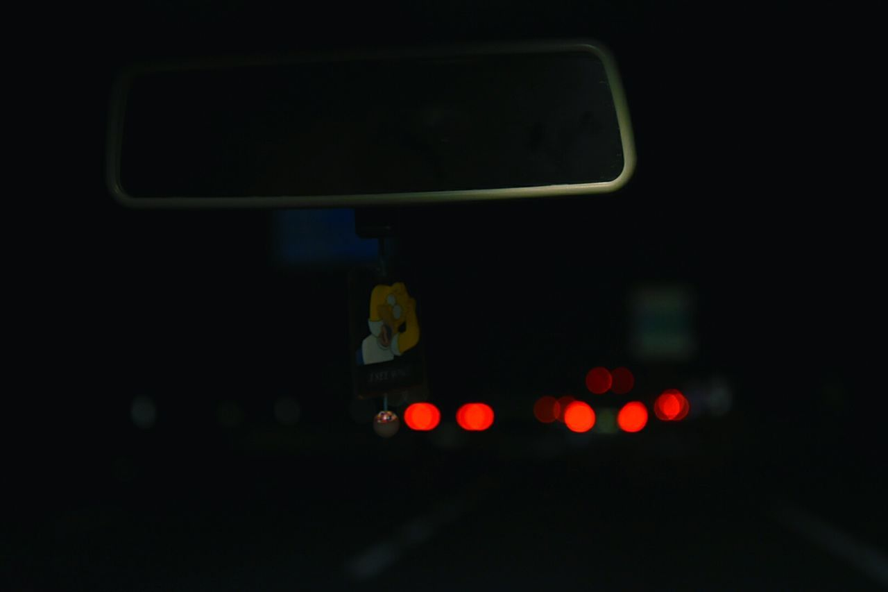 CLOSE-UP OF ILLUMINATED CAR ON NIGHT