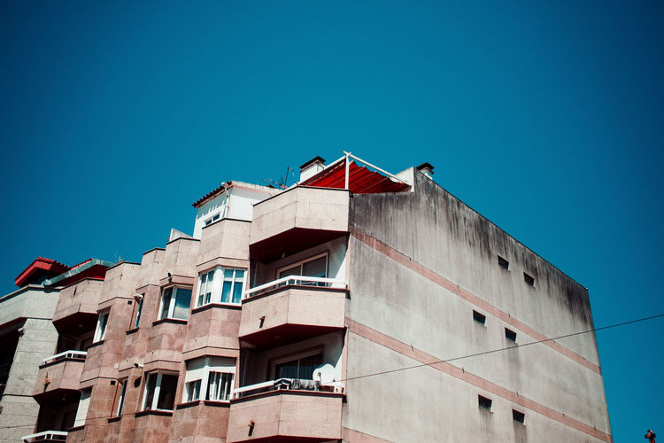 lost in spain Architecture Blue Building Exterior Built Structure Clear Sky Day Hikinggalicia Low Angle View No People Outdoors Red Sky Window
