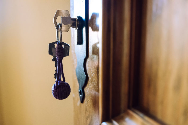 Close-up of key hanging on door