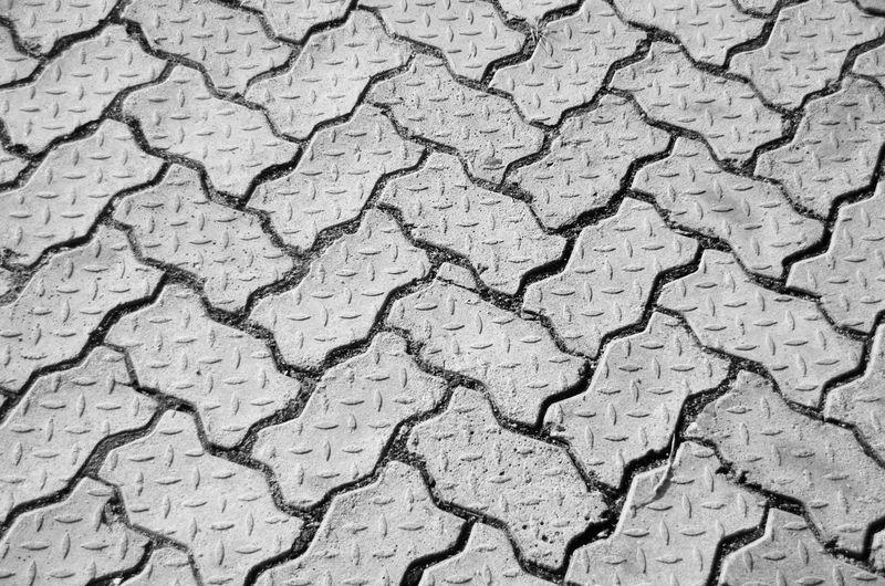 Textured  Backgrounds Pattern Close-up No People Cracked Interlocking Pavement Pavement Patterns Pavement Stone Bricks Pavedstreet Paved Road Paved Path Paved