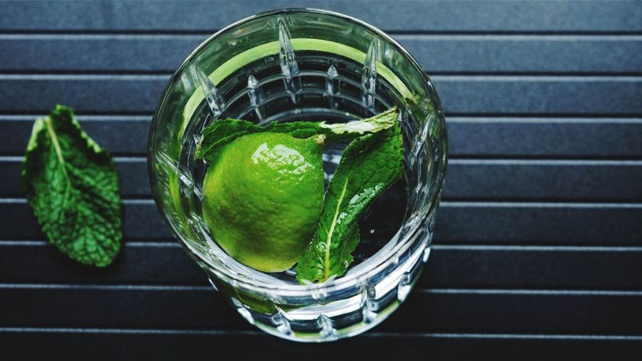 High Angle View Of Lemon And Herb In Drink On Table