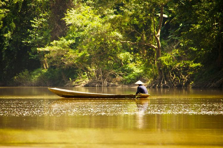 Man Sailing Boat In Lake