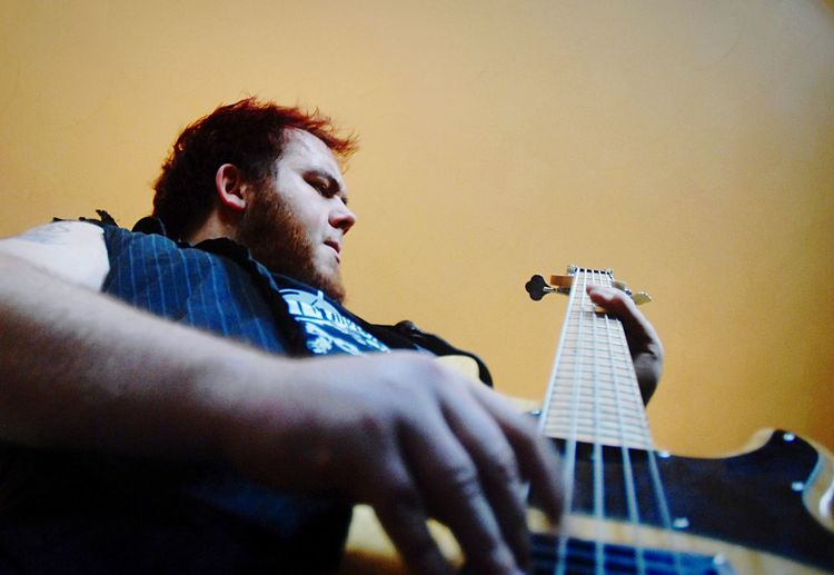 Low angle view of man playing guitar