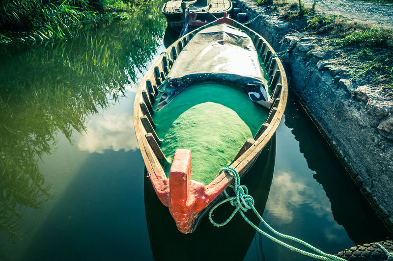 High angle view of boat moored on river