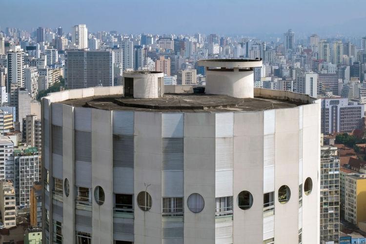 Modern buildings in city against clear sky
