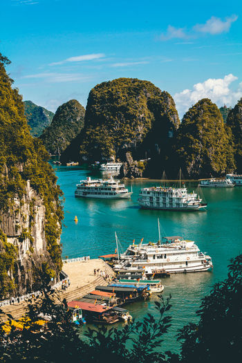 Visiting the famous Ha Long Bay in Vietnam. I was on a guided tour of this cave up in the mountains which enabled me to take this beautiful shot. Architecture Beauty In Nature Day Mode Of Transport Moored Mountain Nature Nautical Vessel No People Outdoors Rock - Object Scenics Sea Sky Transportation Tree Water Waterfront