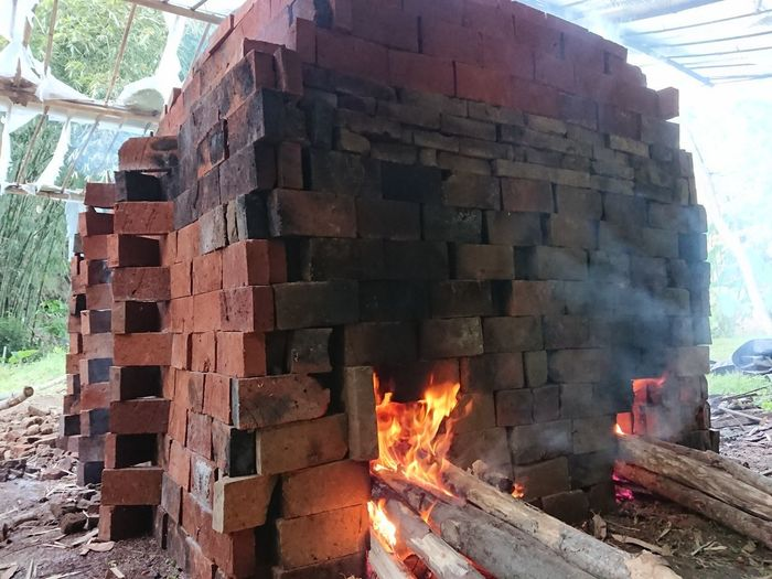 Stack of firewood against built structures