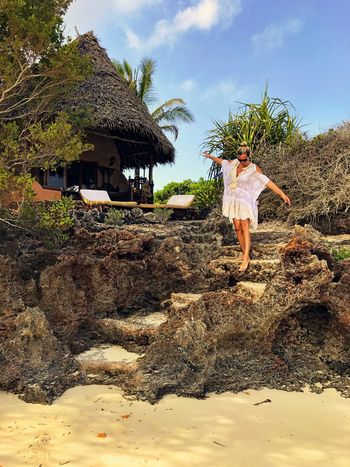 Full Length Thatched Roof One Person Sky Lifestyles Outdoors Tree Vacations Leisure Activity Day Young Women Nature Happiness Bungalow Beachvilla Resort Africa Evening Destination Tranquility Scenics Travel Women Walking Around