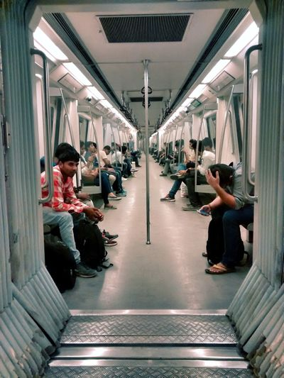 A day in metro. EyeEm Selects Outdoors Mobilephotography Lifestyles Colors PhonePhotography Delhi Men Full Length Exercising Sitting Subway Train Subway Platform Passenger Train Train Interior Train - Vehicle Rail Transportation Metro Train