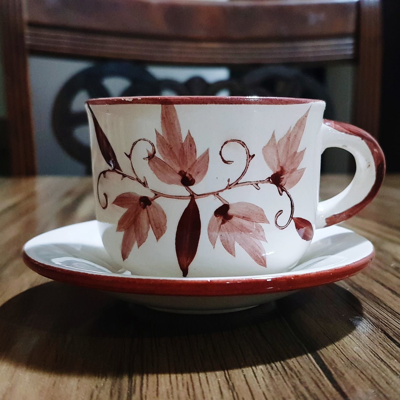 CLOSE-UP OF COFFEE CUP ON TABLE WITH SPOON
