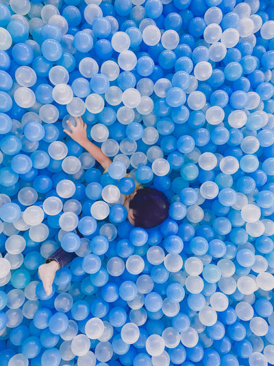 High angle view of man with blue ball