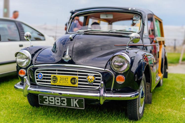 Vintage car parked on field