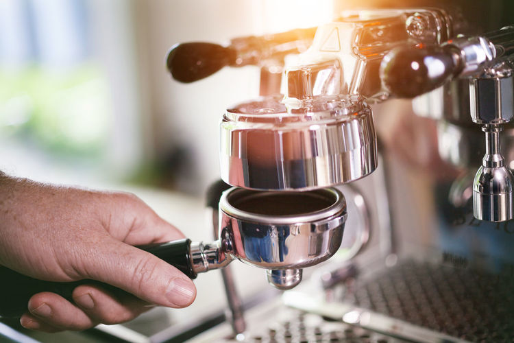 Appliance Barista Cafe Close-up Coffee Coffee - Drink Coffee Maker Coffee Shop Cup Drink Espresso Maker Finger Food And Drink Freshness Hand Human Body Part Human Hand Indoors  Machinery Making One Person Preparation  Refreshment