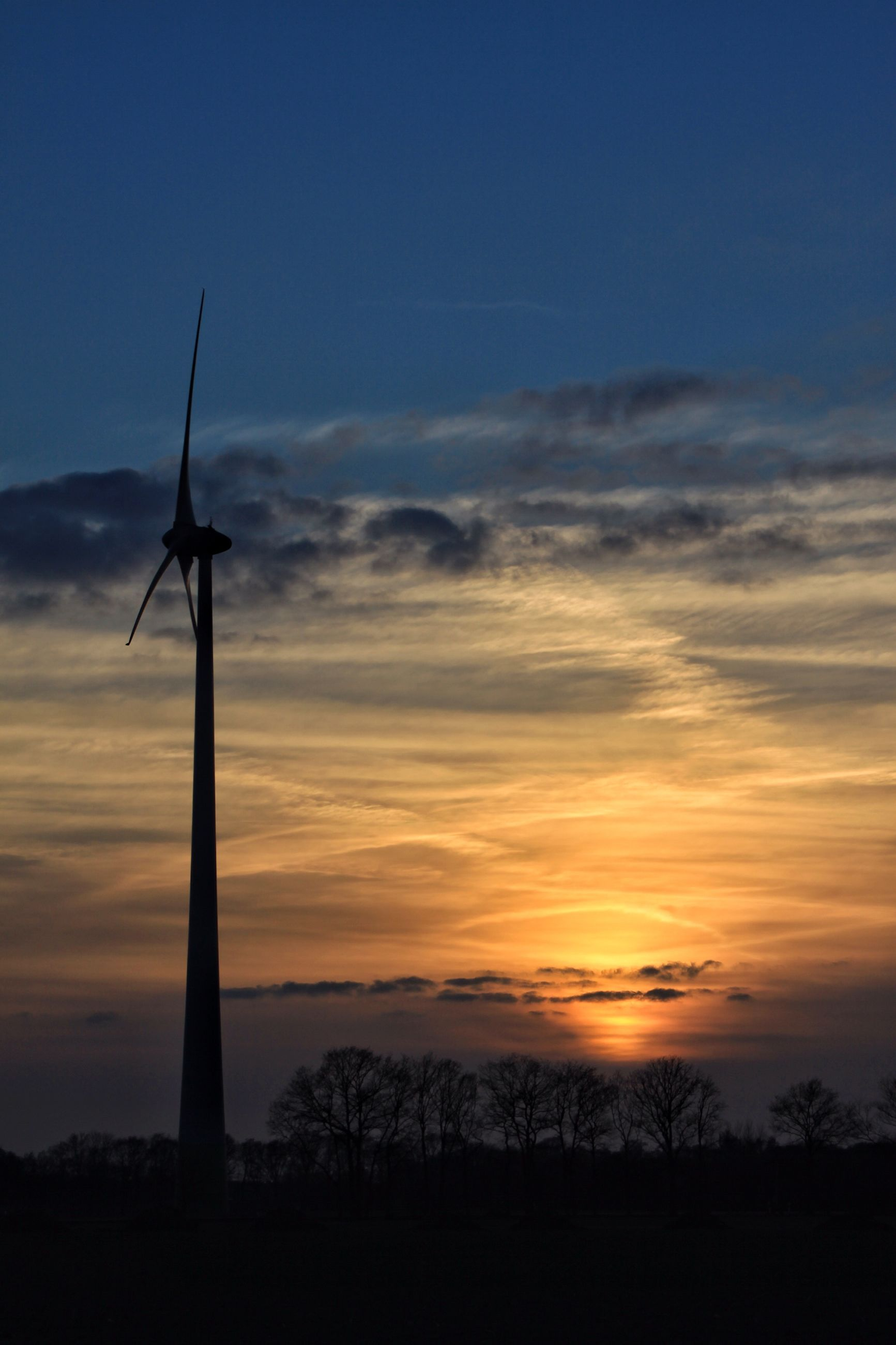 sunset, silhouette, sky, tranquility, scenics, beauty in nature, orange color, tranquil scene, cloud - sky, low angle view, nature, fuel and power generation, landscape, wind turbine, idyllic, field, alternative energy, wind power, cloud, windmill