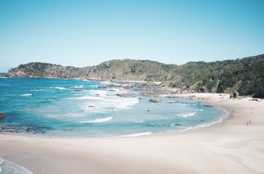 Beach Sea Sand Water Clear Sky Beauty In Nature Nature Scenics Shore Tranquility Blue Tranquil Scene Copy Space Summer Day Outdoors No People Mountain Vacations Landscape Port Macquarie