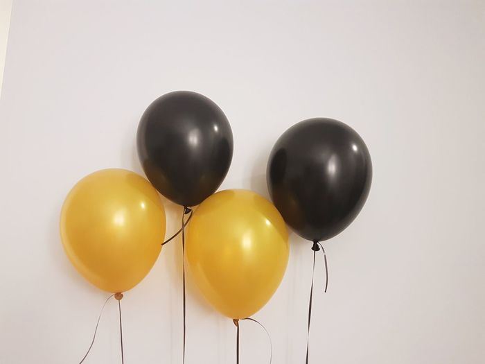 View of balloons against white background