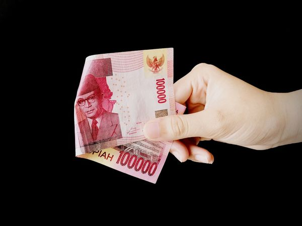 Hand holding Indonesia money. INDONESIA Background Color Abstract Black Art Object Attraction Brown Rupiah 100000 Red Hand Finger EyeEm Selects Human Hand Chance Black Background Gambling Chip Gambling Luck Studio Shot Poker - Card Game Holding Business Finance And Industry Money Currency Paper Currency