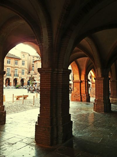 Architecture Built Structure Building Exterior Arch Architectural Column House Day Outdoors History Town Historic Residential District Archway No People Colonnade Architectural Feature Medieval Place Nationale Montauban France Battle Of The Cities