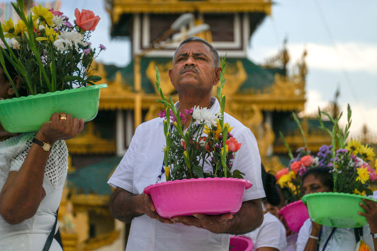 Outdoors Shwedagon Pagoda Spirituality Ceremony Mature Adult Senior Adult Real People Religion Offering To God Sacrifice Buddhism Flowering Plant Flower Adult Day Celebration Incidental People Lifestyles Redefining Menswear