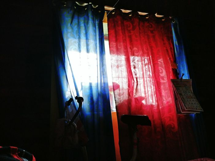 Light outside,dark inside.... Window Curtain Indoors  Darkroom Red Multi Colored Window Curtain Indoors  Home Interior Hanging Textile Darkroom Window Frame Day Red Drapes  Multi Colored