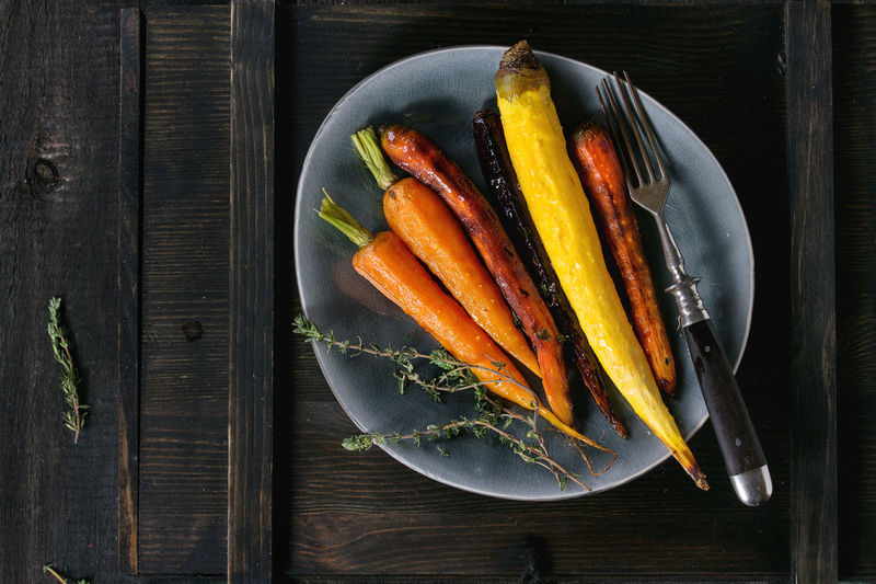 Black Backround Copy Space Dark Dinner Time Herbs Baked Carrots Carrot Carrots Colorful Vegetables Colors Of Food Different Directly Above Food Grilled Vegetables Healthy Eating Healthy Food Rustic Style Top View Of Food Variety Vegan Food Vegetables Veggies Wooden Texture Yellow Carrots