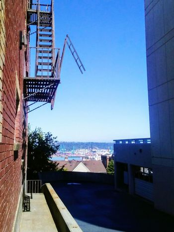 Sky Stairs Industry Industrial Landscapes Streetphotography City Street Skyline Village Life Fireescape Stairs Staircase The Graphic City Architecture Blue Outdoors Clear Sky Built Structure Day Sky Building Exterior No People City EyeEmNewHere Mobility In Mega Cities Colour Your Horizn