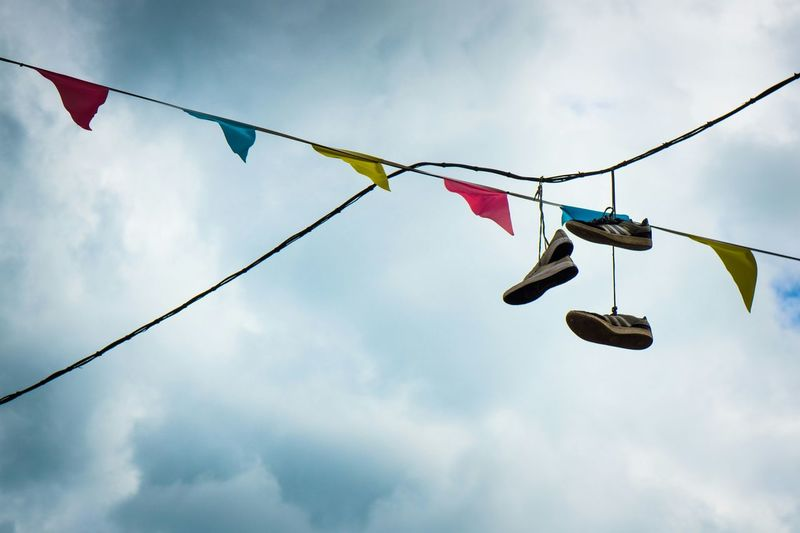 Shoes on a telegraph line Street Photography Bunting Shoes Street Brighton Telegraph