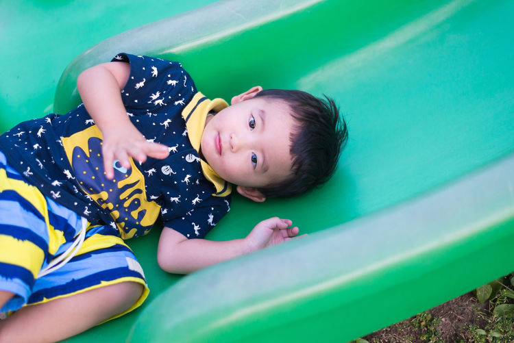 High angle view of cute boy playing on play equipment at park